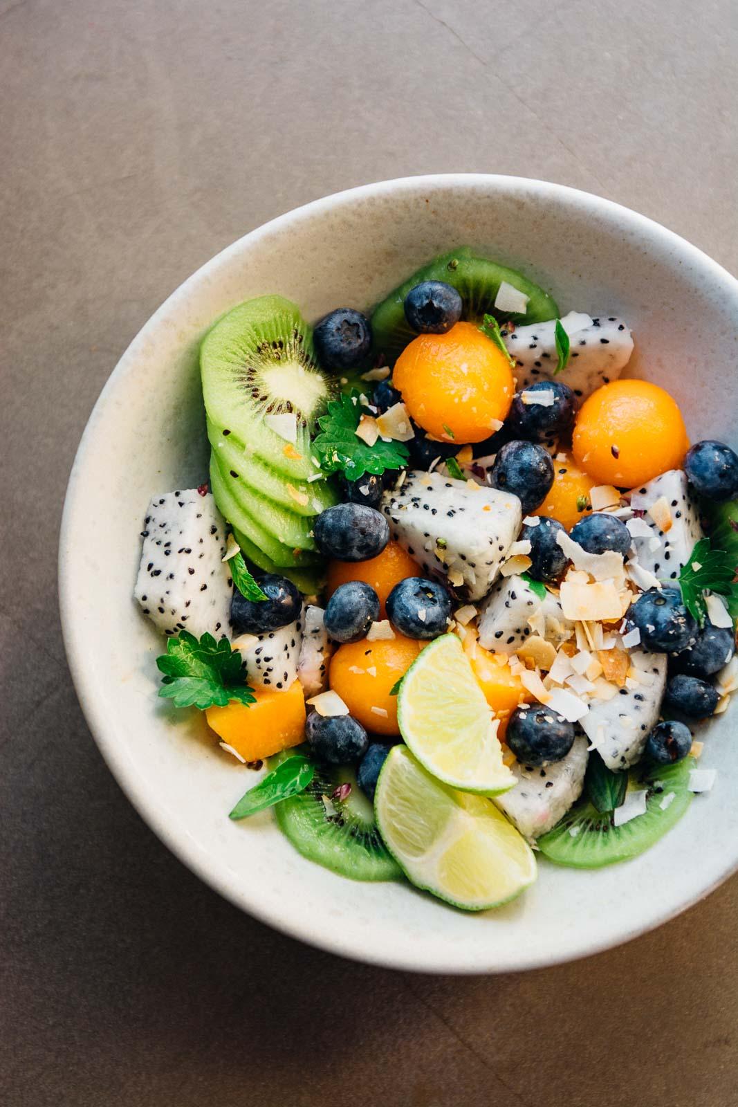 summer tropical fruit bowl with ginger lime dressing | Scaling Back