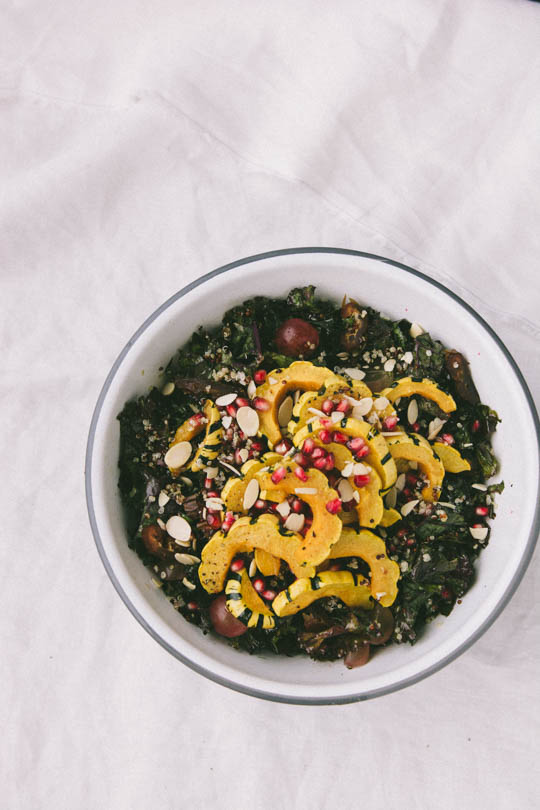 Fall harvest salad - Roasted squash, quinoa, kale, grapes and pomegranates. Perfect for the holidays!