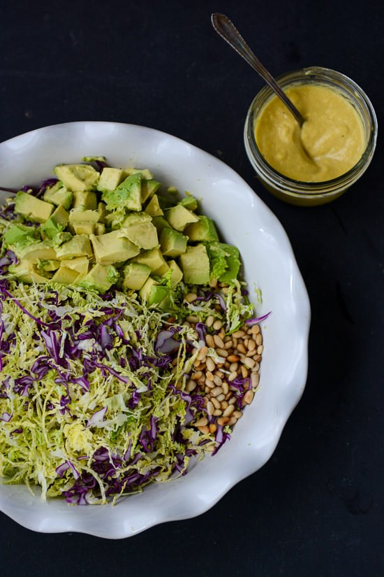Cabbage slaw with roasted onion dressing | Vegan, healthy and full flavor this slaw is full of flavor! www.scalingbackblog.com