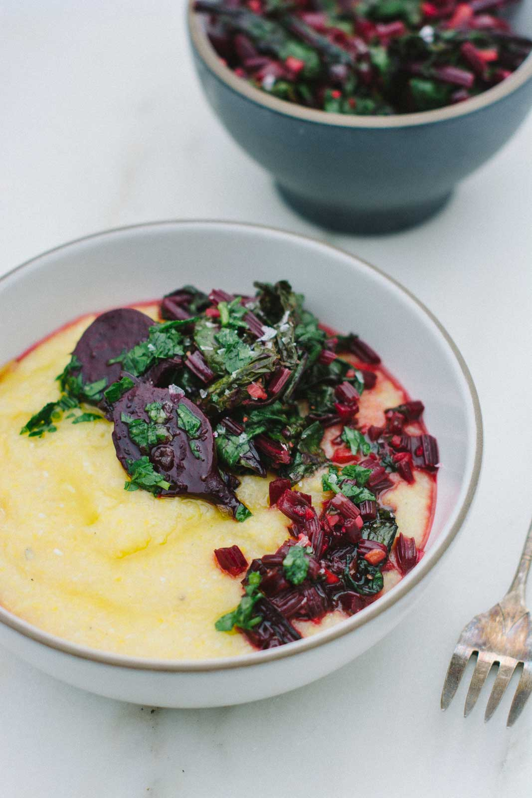 Sautéed beet green and polenta bowl. Don't throw away those tops! | www.scalingbackblog.com