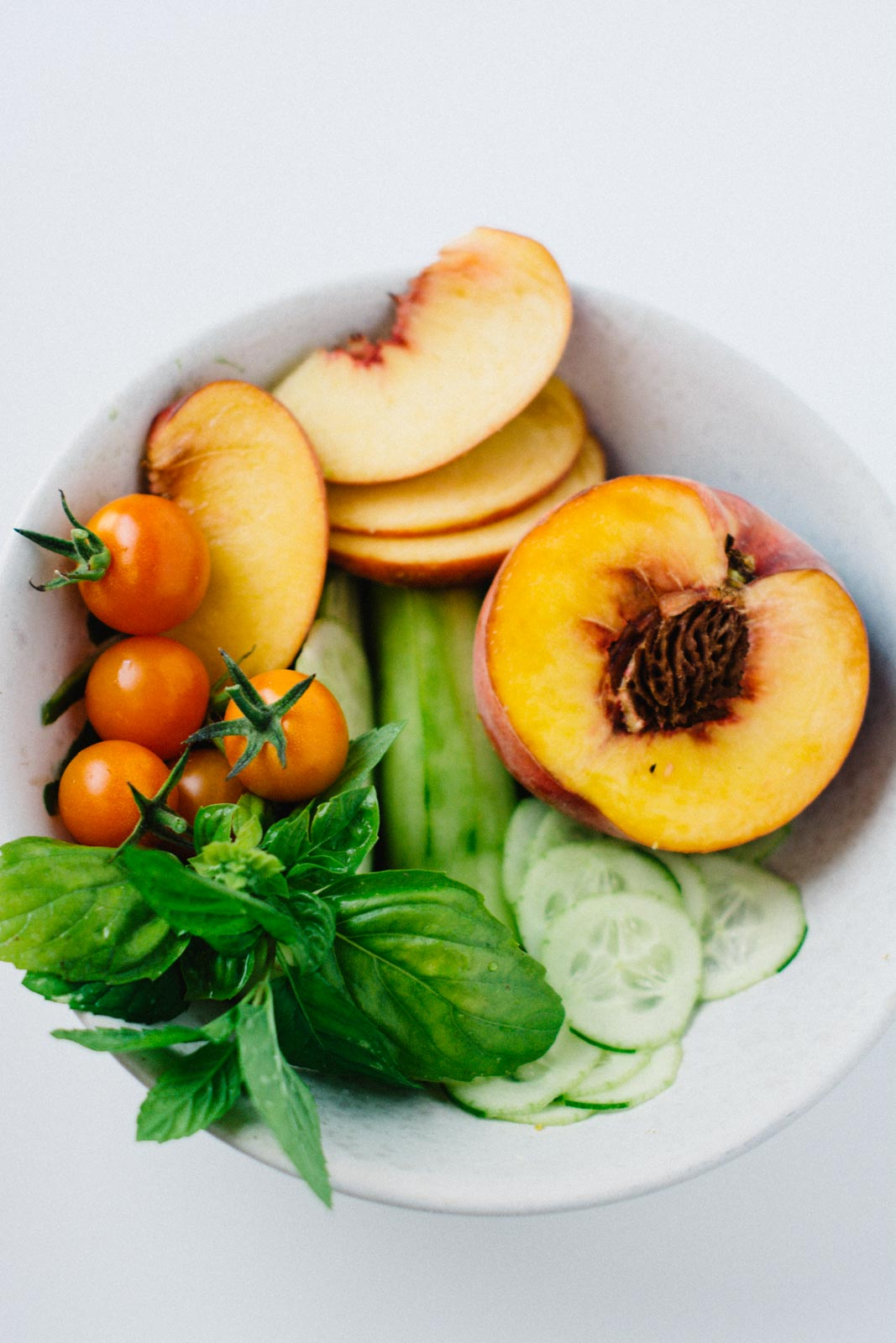 Heirloom tomato, peach and cucumber salad | www.scalingbackblog.com
