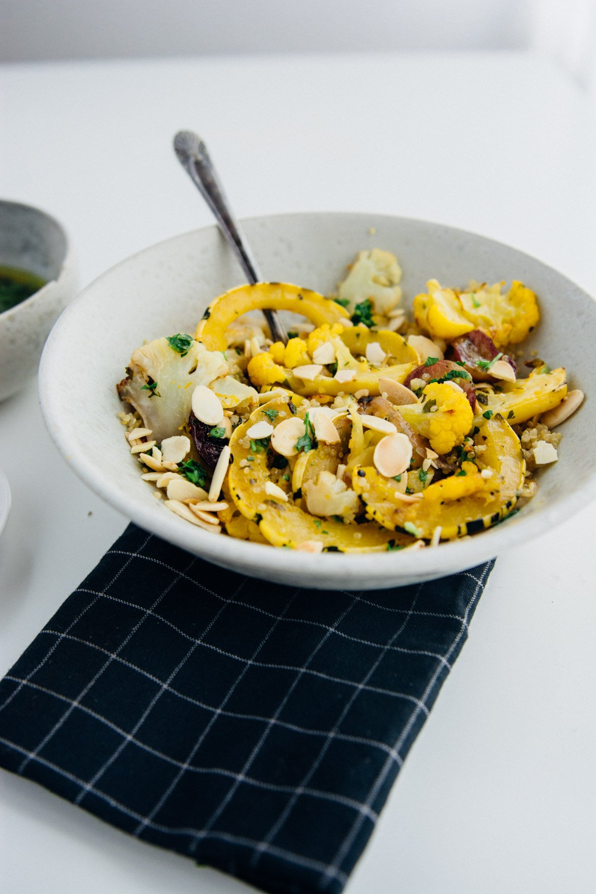 Orange spiced cauliflower and squash bowl | www.scalingbackblog.com
